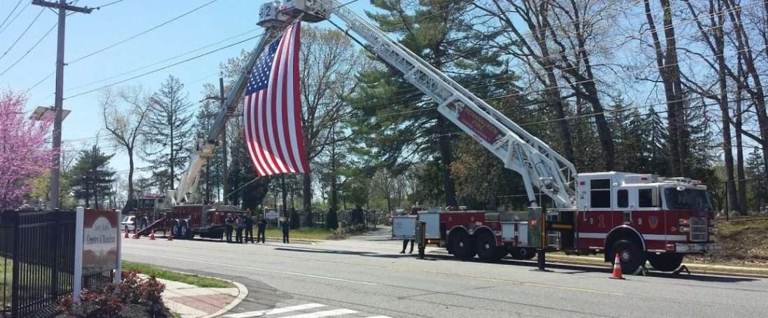 Ladder 82 assists Pennsauken Fire Department with Flag Arch Detail